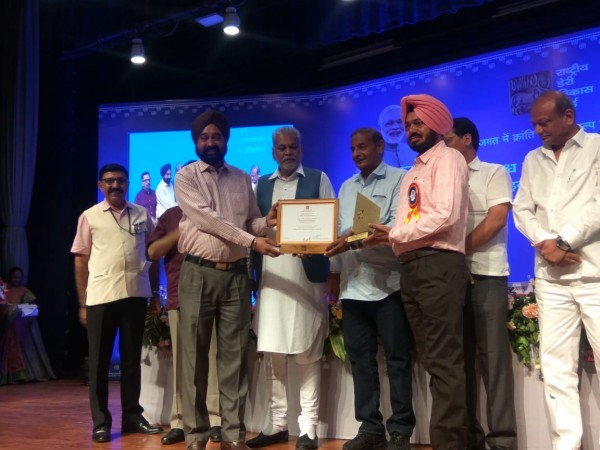 Mohali Dairy recieving the Innovation Award at NDDB Anand on World Milk Day